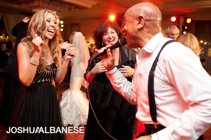 Live performance by Dynasty for wedding at Hilton on Michigan Ave in Chicago, photographed by Joshua Albanese Photography.